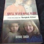 You'll Never Walk Alone: A Woman's Quest for Her Brother's Release from the Bangkok Hilton ราคา 100