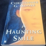A Haunting Smile by Christopher G. Moore ราคา 250